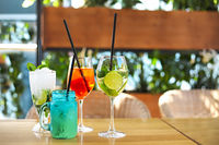 Cocktail glasses on wooden table