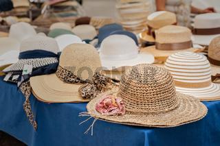 Women's summer hats at the street market.
