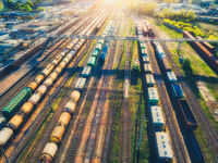 Aerial view of freight cargo trains. Railway station