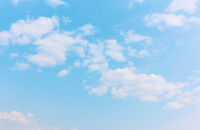 Pastel blue sky with white clouds