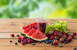fruit and berry juice or smoothie on wooden table