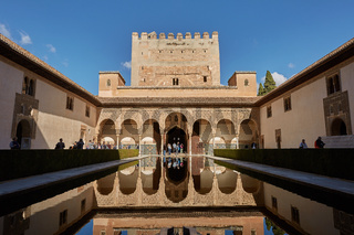 People visiting courtyard of the Myrtles (Patio de los Arrayanes) in La Alhambra, Granada, Spain