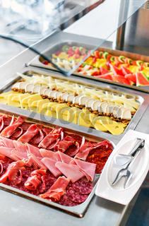 Buffet trays with a various delicious appetizers close-up