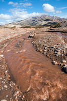 Layered sedimentary rocks in the colorful valley of the Rio Grande (Spanish for