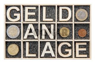 Wooden letters word GELDANLAGE coins