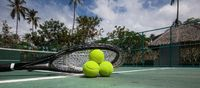 Tennis balls and racket in the court