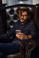 Hipster with smartphone