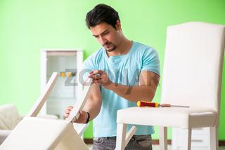 Man repairing furniture at home