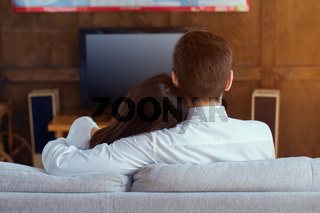 Happy couple watching TV.