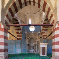 Blue Iznik ceramic tiles wall with engraved Mihrab (niche) and decorated marble Minbar (Platform), Blue Mosque, Cairo, Egypt