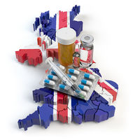 Health, healthcare, medicine and pharmacy in UK Great Britain concept. Pills, vials and syringe on the map of UK isolated on white background.