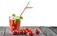 Cherry tomatoes with glass of tomato juice
