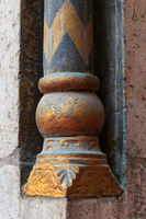 Golden base of a small decorative column with engraved floral inscriptions at the ancient mosque of Sultan Hassan, Cairo, Egypt