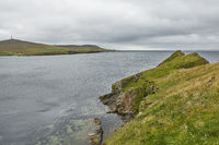 Coastal view toward the Knab in Lerwick, which is the main port on the Shetland Isles, Scotland.