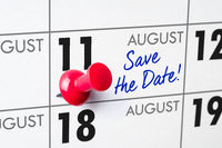 Wall calendar with a red pin - August 11