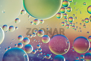 Rainbow abstract defocused background picture made with oil, water and soap