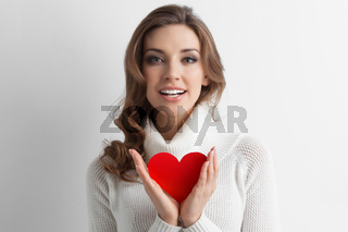 Woman showing paper heart