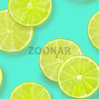 A seamless pattern of lime slices on a vibrant teal blue background, a fruity citrus repeat print