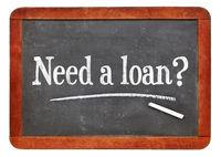 Need a loan? Blackboard sign