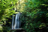 Waterfall at the spa garden in the german city Heilbad Heiligenstadt