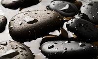 Wet pebbles background wallpaper