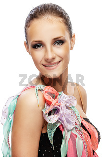 Young smiling beautiful woman with dark hair in motley dress
