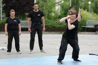 Policemen demonstrate martial arts