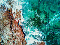 Aerial topdown views of the pristine ocean and rocks Durras