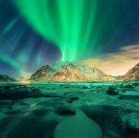 Aurora over snowy mountains. Northern lights