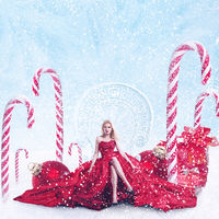 Concept fantasy winter portrait of young fashion woman with gift boxes and christmas decorations