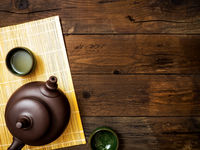 Teapot on the bamboo mat. Top view