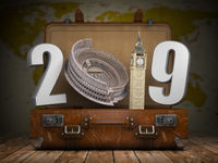 2019 Happy new year. Vintage suitcase with number 2019 as Coloisseum and Big Ben tower. Travel and tourism concept.