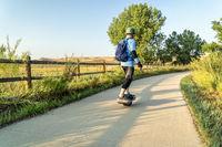 riding electric skateboard on bike trail