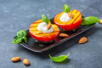 Grilled peach with honey, yogurt and almonds.