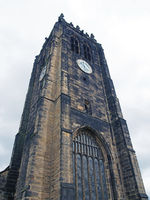 the tower and clock of halifax minster a medieval church in west yorkshire
