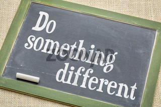 Do something different note on slate blackboard