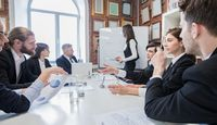 Business presentation on whiteboard