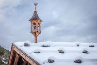 Snowy belfry on a hut