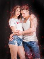 Romantic couple embracing in studio shot on white