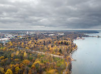 drone view of autumn suburban parks of St. Petersburg with palaces on the shores of the Gulf of Finland on a cloudy day