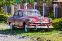 old red pontiac car
