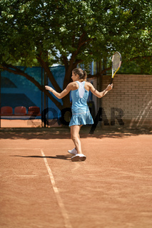Sportive girl plays tennis