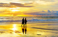 Couple walking tropical  beach romantic