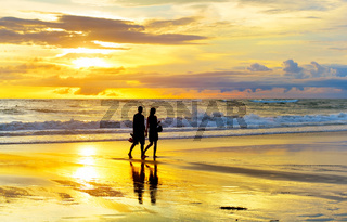 Couple walking tropical  beach romantic