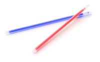 Two plastic glow sticks