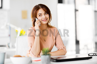 businesswoman calling on smartphone at office
