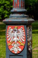 Wappen an einer Laterne in Berlin