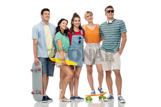 friends with skateboards over white background