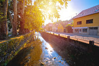 Town of Samobor river and park sun haze view