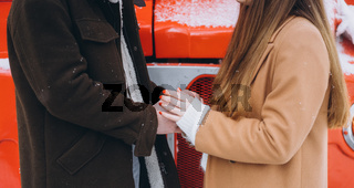 Couples holding hands in the winter season